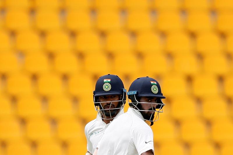India's Lokesh Rahul and Shikhar Dhawan run between wickets in Third test match between Sri Lanka and India in Pallekele, Sri Lanka, on August 12, 2017. Photo: Reuters