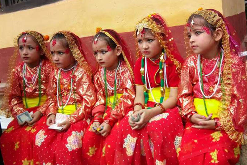 Panch Kanya, clad in traditional attires wait to take part in Gaijatra procession in Phidim, district headquarters of Panchthar, on Tuesday, August 8, 2017. Photo: Laxmi Gautam