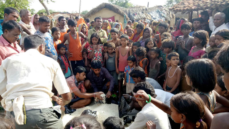 Relief items being distributed to flood victims at Pakaha Mainpur of Parsa district, on Tuesday, August 15, 2017. Photo: Ram Sarraf