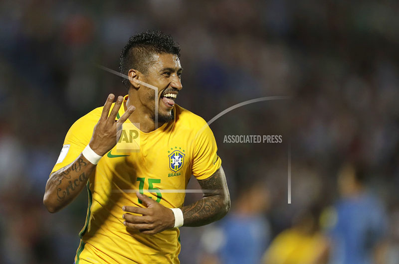 FILE- In this Thursday, March. 23, 2017 file photo, Brazil's Paulinho celebrates his hat trick during a 2018 World Cup qualifying soccer match against Uruguay in Montevideo, Uruguay. Photo: AP