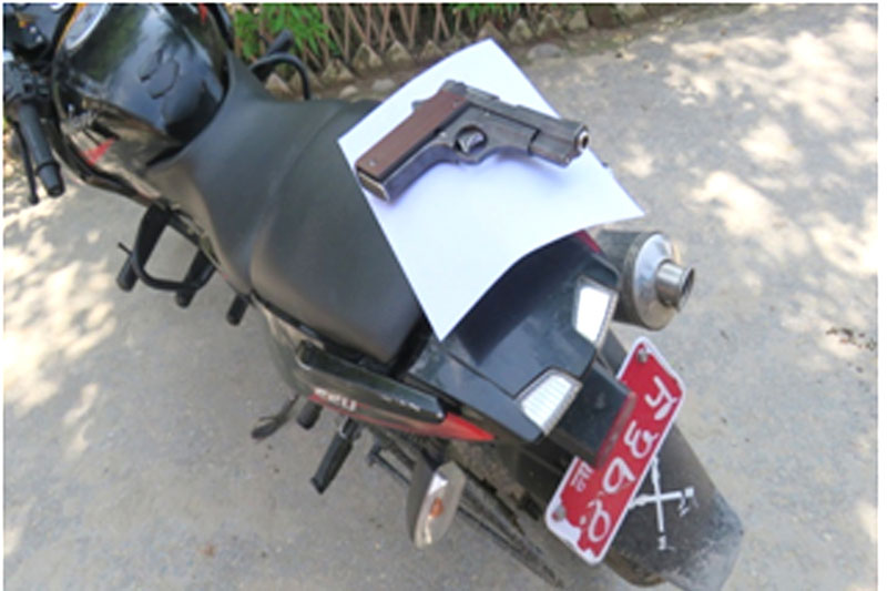 A pistol and a bike sized by police at Tanahun District Police Office, on Tuesday, August 8, 2017. Photo: Madan Wagle