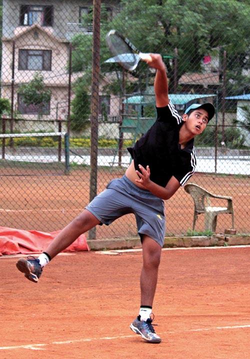 Pranav Khanal serves to Samyak Bhushan Bajracharya during the U-16 boysu2019 singles semi-final match of the ANLTA-JTI National Junior Tennis Tournament on Tuesday. Photo: THT