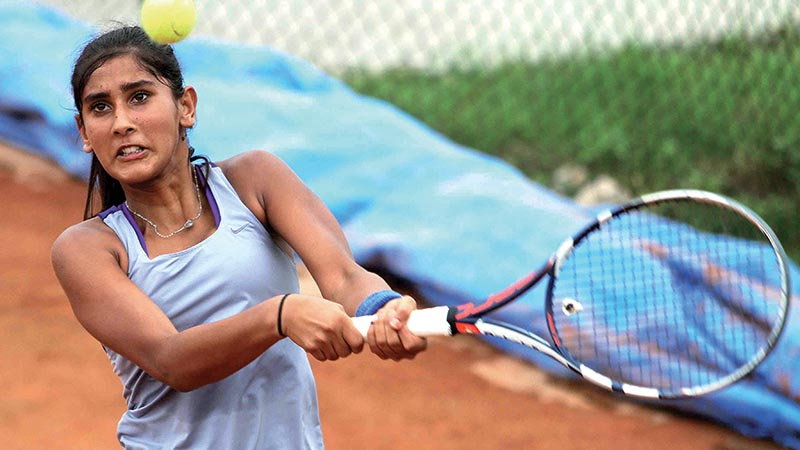Prerna Koirala returns to Saloni Tamang during their girlsu2019 U-14 final of the ANLTA-JTI National Junior Tennis Tournament at the Satdobato Tennis Complex in Lalitpur, on Thursday. Photo: Udipt Singh Chhetry/ THT