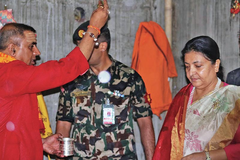President Bidya Devi Bhandari receiving blessing from a priest in Doleshwor temple, Bhaktapur, on Tuesday, August 22, 2017. Photo: RSS