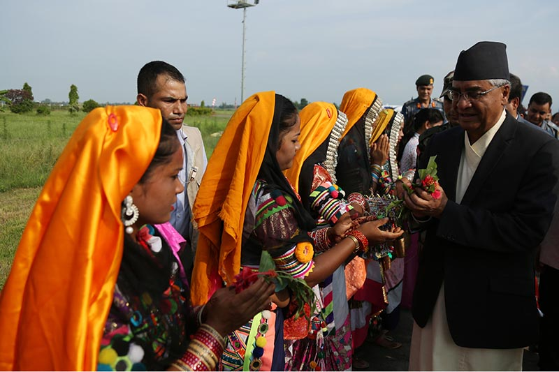 Women from local community welcome Prime Minister Sher Bahadur Deuba at the Dhangadhi Airport in Kailali district, on Thursday, August 31, 2017. The PM is due to lay a foundation stone for the construction of a four-lane bridge over the Mahakali River in Kanchanpur today. Photo: RSS