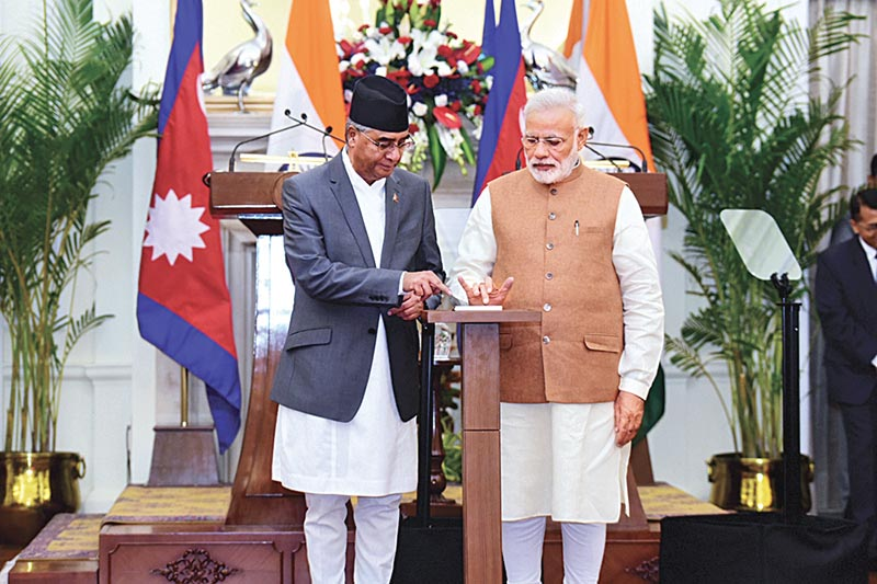 Prime Minister Sher Bahadur Deuba and his Indian counterpart Narendra Modi inaugurating Kataiya-Kushaha cross-border transmission line for supply of 50 MW via remote control, before addressing joint press conference, in Delhi, on Thursday, August 24, 2017. Photo courtesy: Embassy of Nepal, New Delhi