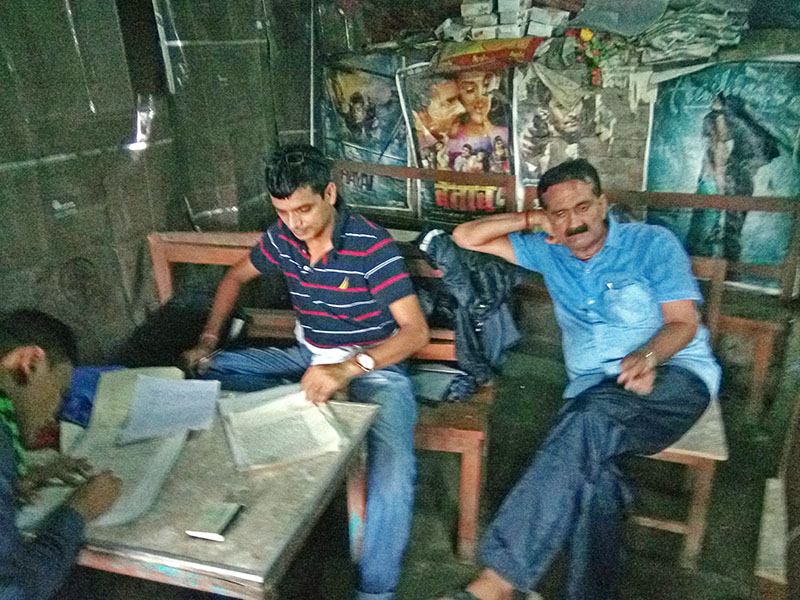 CIAA officials prepare file against sub engineer Lalan Kumar Singh (right) looks dejected after his arrest in Gaur of Rautahat district, on Friday, August 11, 2017. Photo: Prabhat Kumar Jha