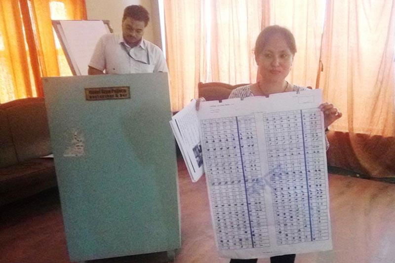 A District Election Office staffer showing a ballot paper at an interaction on local election and its system in Gaur, Rautahat, on Tuesday, August 29, 2017. Photo: THT