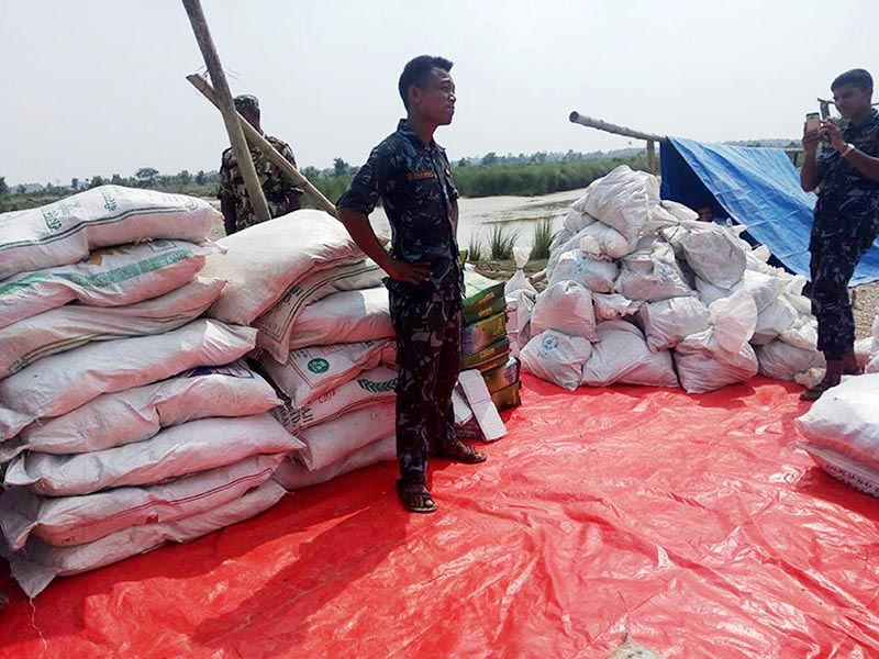 Relief materials collected by Chaudhari Group and Plan Nepal being prepared for distribution among flood victims at Debahi, in Rautahat district, on Thursday, August 17, 2017. Photo: THT