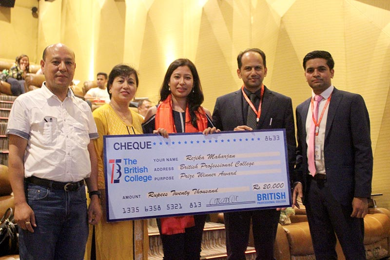 Rejika Maharjan, a student from The British College, being honoured  after she topped P3 Business Analysis professional Association of Chartered Certified Accountants (ACCA) paper, in the June 2017 exams, ranking number one in the world, in Kathmandu, on August 3, 2017. Photo: The British College
