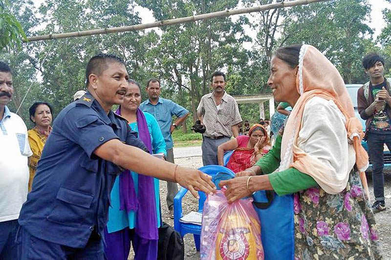 A flood victim receives relief items in Dang district, on Wednesday, August 16, 2017. Photo: RSS