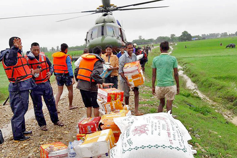 Helicopter being used to supply relief packages to the flood victims in Rapti Pari in Mid-Western Nepal on Tuesday, August 15, 2017. Photo: RSS