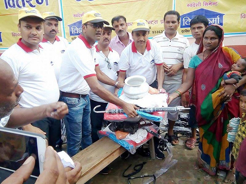Representatives of Bishwokarma Cement Pvt Ltd distributing relief materials to flood victims in Gaur, Rautahat district on Thursday, August 17, 2017. Photo: THT