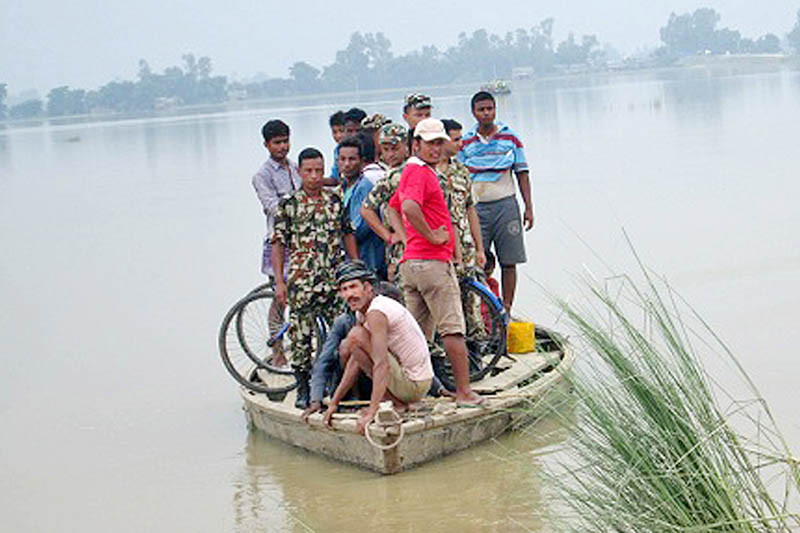 Nepali Army personnel rescuing local in Kailali district, on Friday, August 18, 2017. Photo: RSS