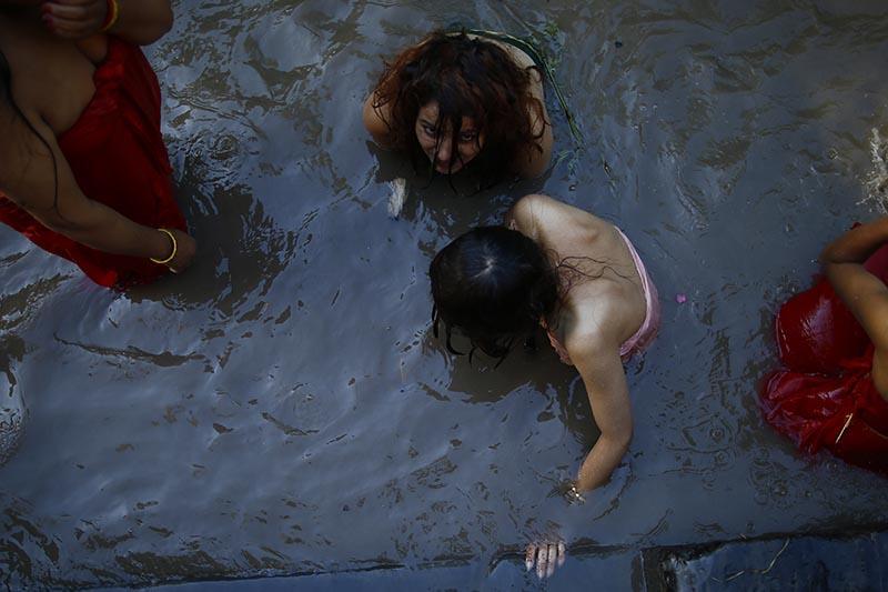 Hindu devotee women take holy dip during Rishipanchami festival in the Bagmati River in Kathmandu, on Saturday, August 26, 2017. Photo: Skanda Gautam