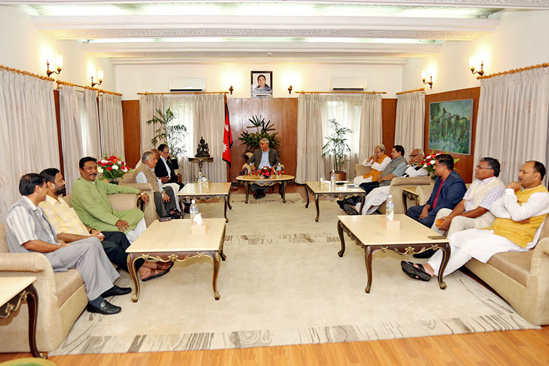 Prime Minister Sher Bahadur Deuba along with other ruling parties leaders hold a meeting with leaders of Rastriya Janata Party Nepal at PM's official residence in Baluwatar, on Friday, August 11, 2017. Photo: RSS