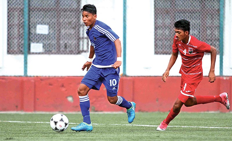 Nepalu2019s Brijesh Chaudhary (left) dribbles the ball past Ibrahim Anoof of the Maldives during their SAFF U-15 Championship match at the ANFA Complex grounds in Lalitpur on Monday. Nepal won the match 6-0. Photo: Udipt Singh Chhetry / THT