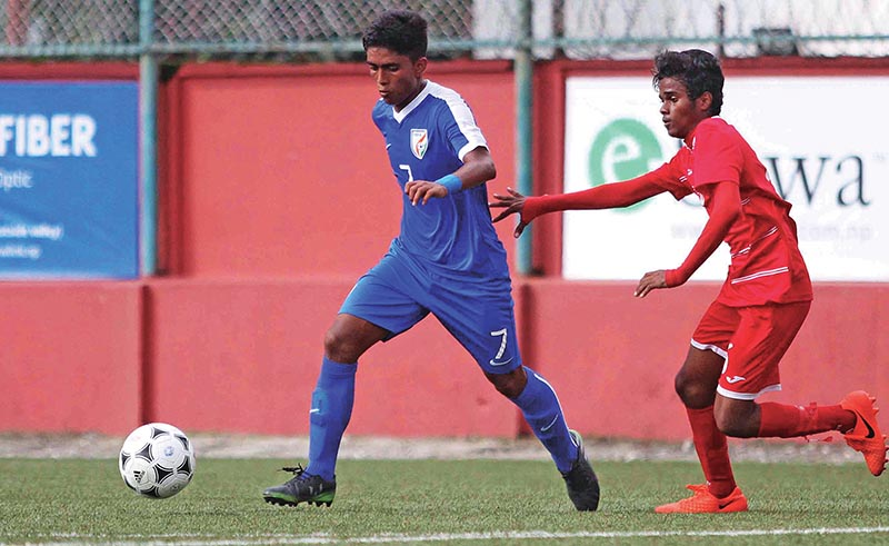 Indiau2019s Ravi Bahadur Rana (left) dribbles the ball past a Maldivian player during their SAFF U-15 Championship match at the ANFA Complex grounds in Lalitpur on Saturday. India won the match 9-0. Photo: Udipt Singh Chhetry / THT
