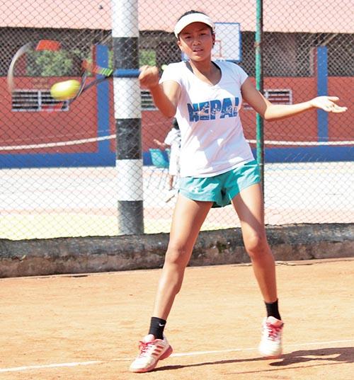 Saloni Tamang of Little Angelsu2019 School returns to Shirista Rai of Elim Kids Academy during their LA-JTI Inter-school Junior Open Tennis Tournament match in Lalitpur, on Thursday. Photo: THT