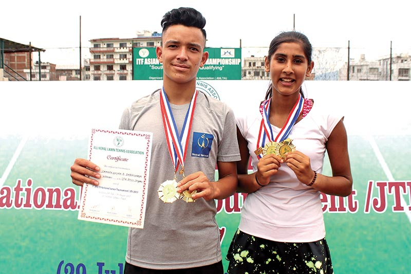Samrakshyak Bhushan Bajracharya and Prerana Koirala hold the medals after the first ANLTA-JTI National Junior Tennis Tournament in Lalitpur, on Saturday. Photo: THT