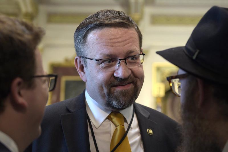 Deputy assistant to President Trump, Sebastian Gorka, talks with people in the Treaty Room in the Eisenhower Executive Office Building on the White House complex in Washington during a ceremony commemorating Israeli Independence Day, on  Tuesday, May 2, 2017. Photo: AP