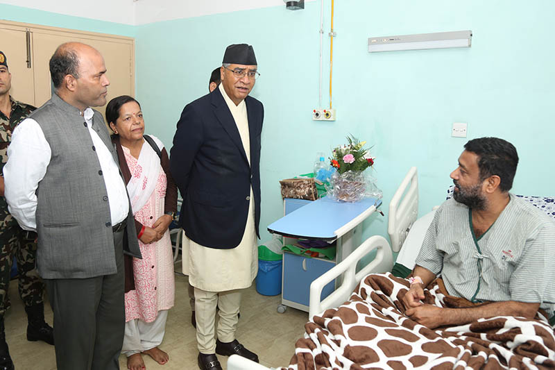 Prime Minister Sher Bahadur Deuba taking stock of former DPM Bimalendra Nidhi's health at OM Hospital and Research Centre in Kathmandu, on Wednesday, August 16, 2017. Photo: RSS