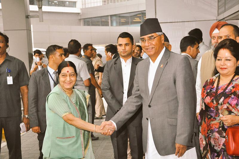 Indian External affairs Minister Sushma Swaraj (left) receives Prime Minister Sher Bahadur Deuba, at the Indira Gandhi International airport in New Delhi, India, on Wednesday, August 23, 2017. Deuba is on a five-days visit to India. Photo: MEAIndia