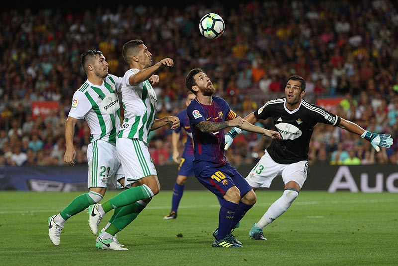 Betis' Alin Tosca, Zouhair Feddal and Antonio Adan in action with Barcelonau2019s Lionel Messi in the La Liga match between Barcelona and Real Betis, in Barcelona, Spain, on August 20, 2017. Photo: Reuters