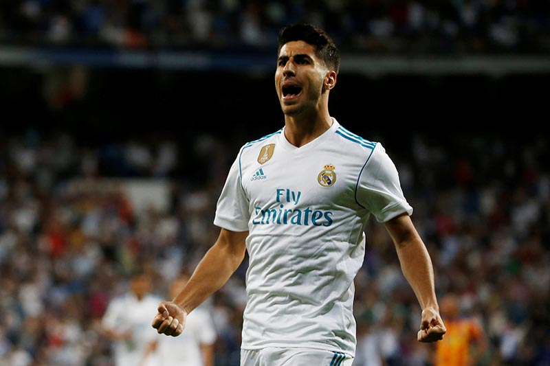 Real Madridu2019s Marco Asensio celebrates scoring their first goal during the Spanish La Liga Santander match between Real Madrid and Valencia, in Madrid, Spain, on Sunday August 27, 2017. Photo: Reuters