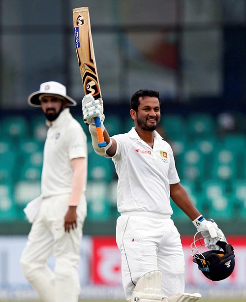 Sri Lanka's Dimuth Karunaratne celebrates his century in the Second Test Match between Sri Lanka and India, in Colombo, Sri Lanka, on August 6, 2017. Photo: Reuters