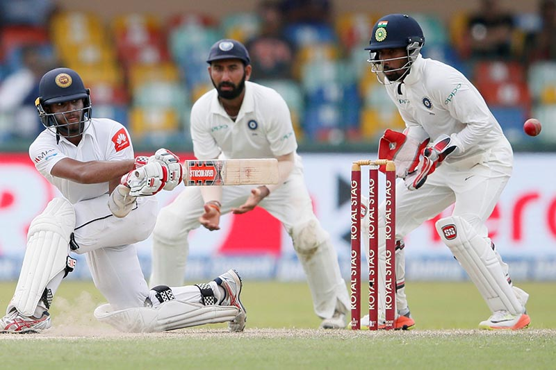 Sri Lanka's Kusal Mendis watches his shot, in Second Test Match between Sri Lanka and India, in Colombo, Sri Lanka, on August 5, 2014. REUTERS/Dinuka Liyanawatte
