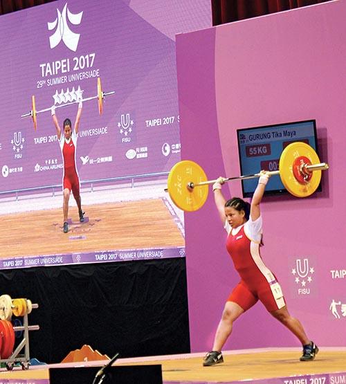Nepali weightlifter Tika Maya Gurung lifts weight during the 29th Summer Universiade in Chinese Taipei on Monday. Photo: THT