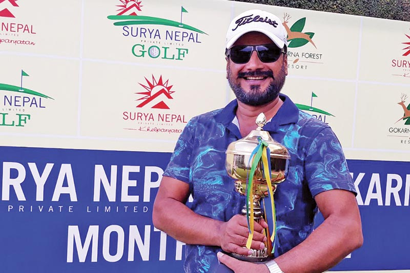 Devendra Bajgai holds the trophy after winning the sixth edition of the Surya Nepal Gokarna Monthly Medal at the Gokarna Golf Club in Kathmandu on Saturday. Photo: THT