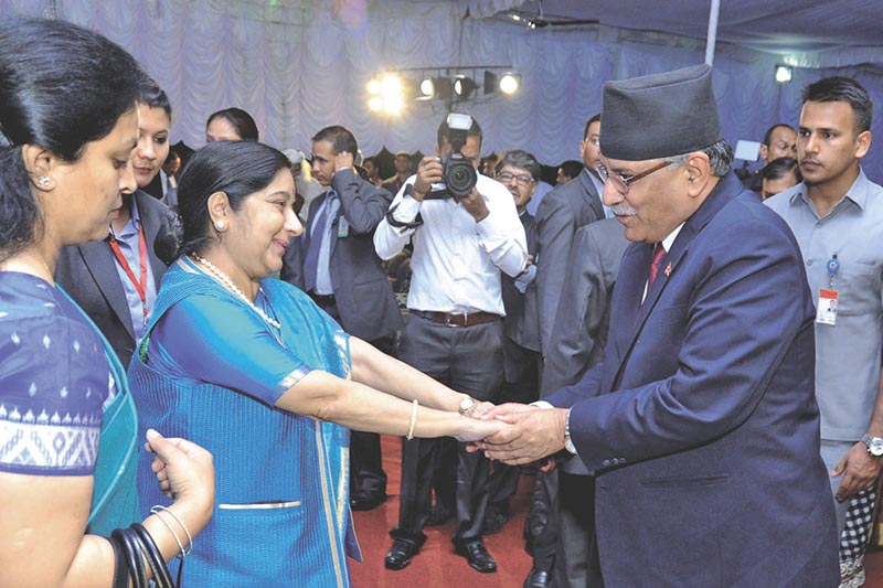 Indian Minister of External Affairs Sushma Swaraj  and CPN-Maoist Centre Chairman Pushpa Kamal Dahal sharing a light moment at a reception hosted at India House, in Kathmandu, on Friday, August 11, 2017. Photo: THT