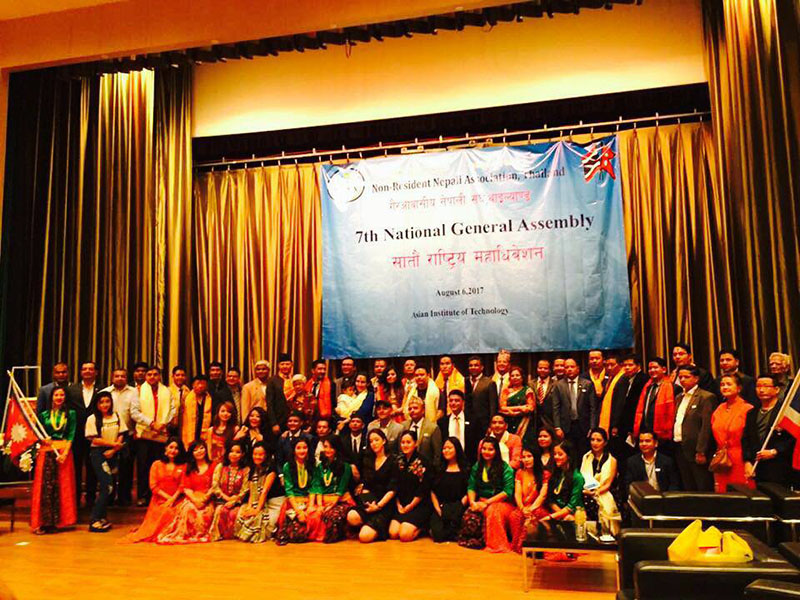 Nepalis residing in Thailand pose for a portait after the 7th National General Assembly in Bangkok.