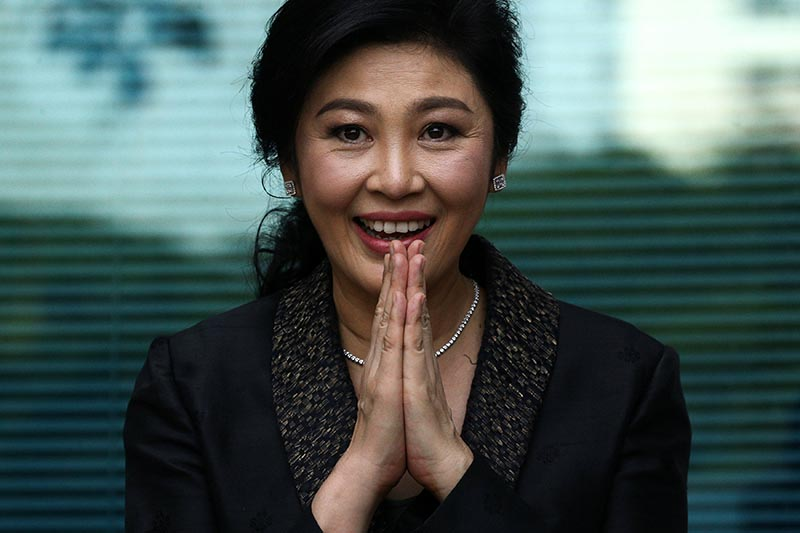 Ousted former Thai prime minister Yingluck Shinawatra greets supporters as she arrives at the Supreme Court in Bangkok, Thailand, on August 1, 2017. Photo: Reuters