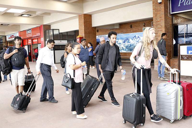 Tourists returning to their countries after visiting Nepal at the Tribhuvan International Airport, in Kathmandu, on Thursday, August 17, 2017. Photo: RSS