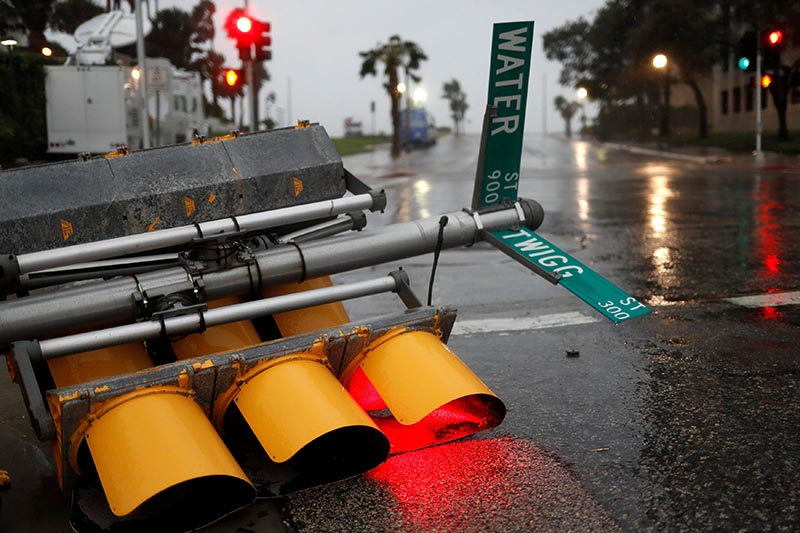 Traffic lights lie on a street after being knocked down, as Hurricane Harvey approaches in Corpus Christi, Texas, US, on  August 25, 2017. Photo: Reuters