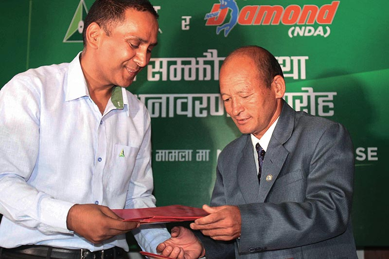 Vice-president, Sales and Marketing at Shivam Cement Sajan Devkota and NDA coach Kumar Rai (right) exchange the MoU at a programme in Kathmandu on Saturday. Photo: THT