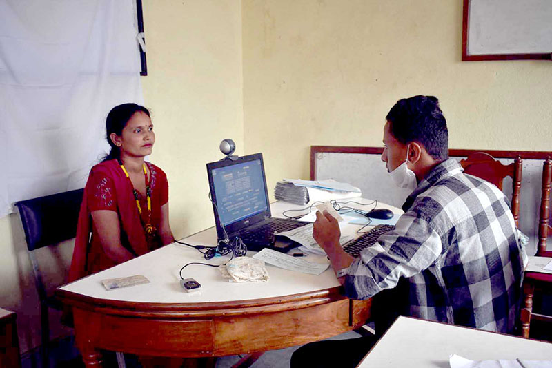 A government official takes picture of a woman for registration in voters list at Banepa in Dhulikhel Municipality, on Monday, August 14, 2017. Photo: RSS