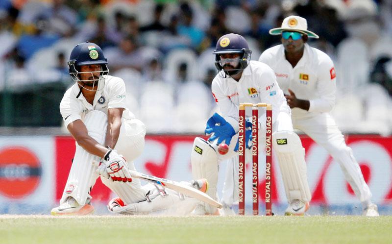 India's Wriddhiman Saha plays a shot. Photo: Reuters