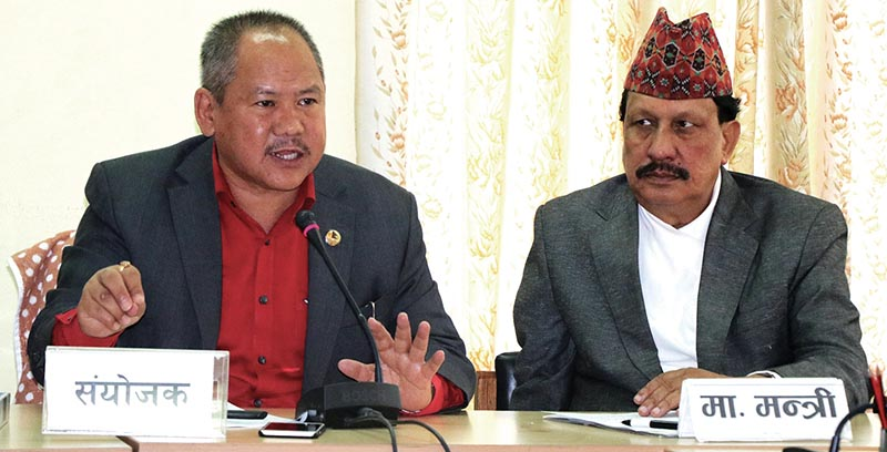 Convenor of Youth and Sports Sub-committee Mohan Rai speaks as Minister for Youth and Sports Rajendra Kumar KC looks on during an interaction programme on Tuesday. Photo: THT