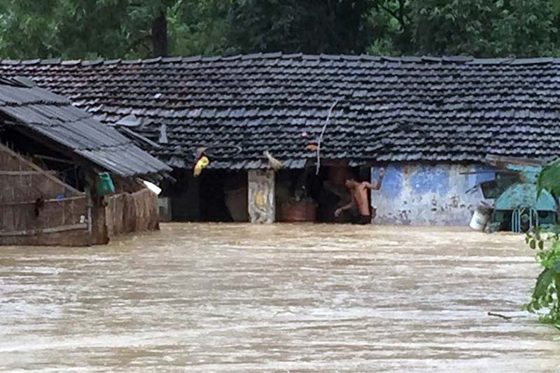 Houses are seen submerged after the swollen Babai River gushed into the settlement in Gulariya Municipality-10, Bardiya, on Sunday, August 13, 2017. Photo: Damodar Bhandari