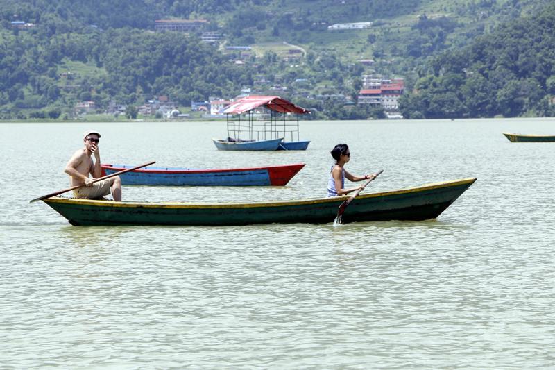 Tourists enjoy a boat ride on Phewa Lake, Pokhara, on Monday, August 7, 2017. Photo: RSS