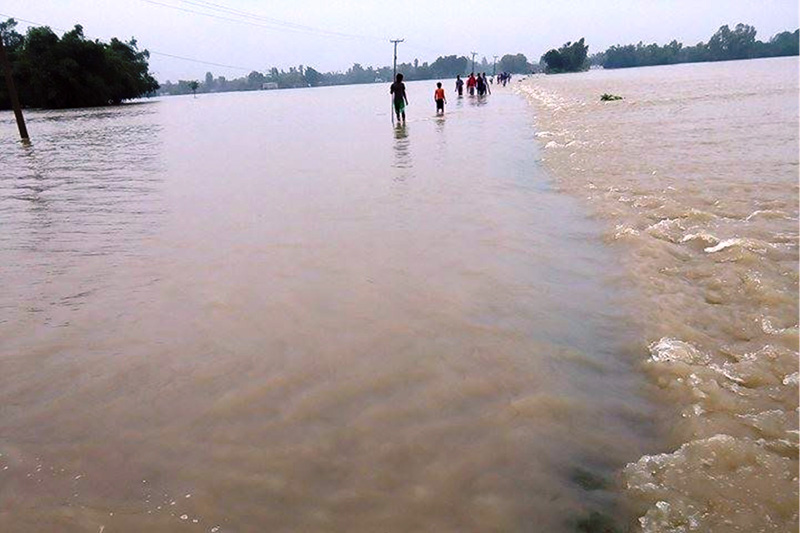 A view of the road that has turned into a river due to monsoon flooding in Rautahat, on Staurday, August 12, 2017. Photo: Prabaht Jha