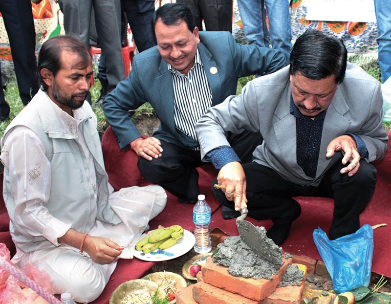 Minister for Youth and Sports Rajendra Kumar KC laying the foundation stone of the multipurpose covered hall  on the Tribhuvan University premises as National Sports Council Member Secretary Keshab Kumar Bista looks on, in Kirtipur on Tuesday. Photo: Udipt Singh Chhetry/ THT
