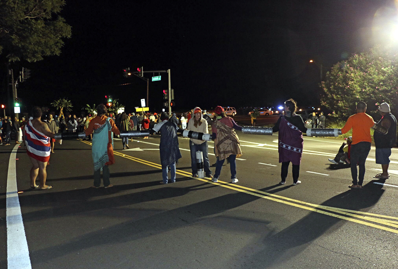 This Wednesday, August 2, 2017, photo provided by the Hawaii Department of Land and Natural Resources (DLNR) shows protestors blocking the intersection of Kula Highway and Old Haleakala Highway in Maui, Hawaii. Photo: AP