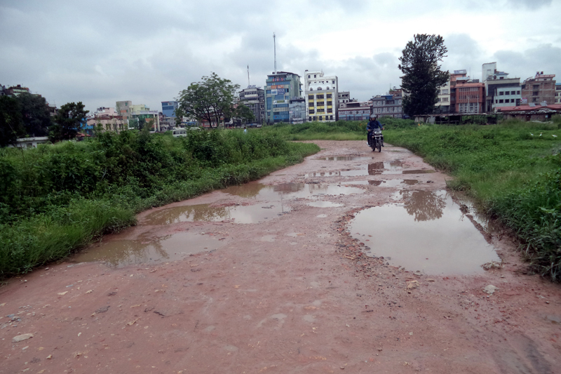 A motorcyclist tries to escape the puddles in the Singhadarbar area, Kathmandu, on Thursday, August 3, 2017. Photo: RSS