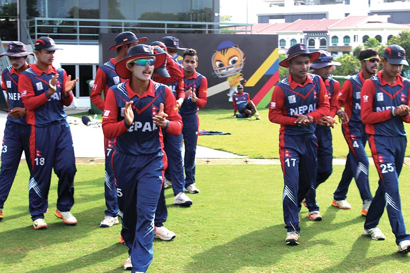 Nepal U-19 cricket team players celebrate after beating  Malaysia in the semi-final match of the ACC U-19 Eastern Regional Tournament, at the Club AMan in Kuala Lumpur on Saturday. Photo Courtesy: NSJF