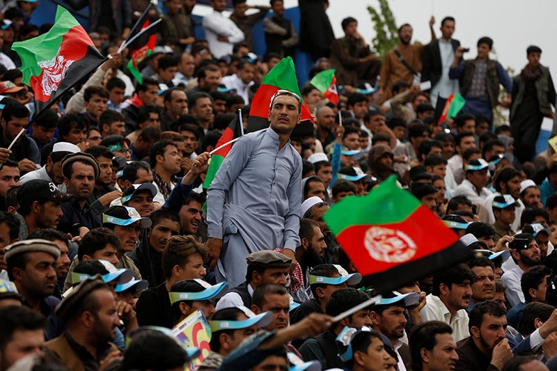 Afghan cricket fans celebrate during the Afghanistan's Shpageeza T20 cricket tournament the main stadium in Kabul, Afghanistan, on September 15, 2017. Photo: Reuters